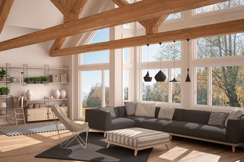 living room with vaulted ceiling and large windows